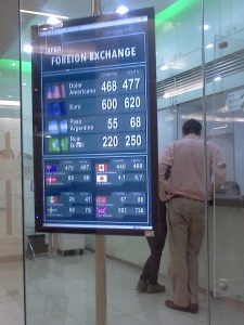 Foreign Exchange Rates available in the Costanera Center, March 27, 2013. (Photo: Darren Popik)