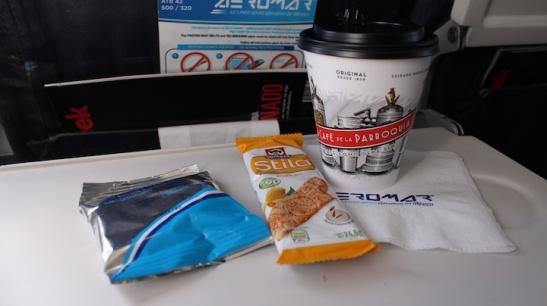 Coffee and snacks - japanese peanuts, and Quaker mango bar. (Photo: Darren Popik)
