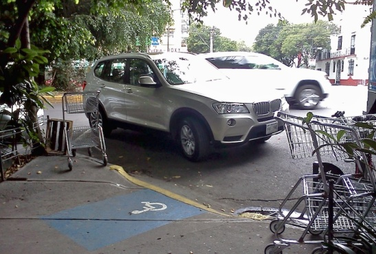 Parking on a Corner ... blocking the handicapped. You're such a winner.
